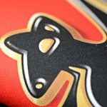 advert mat close up in black, gold and red