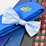 a selection of digitally printed ties close up in a range of colours including a bow tie is possible