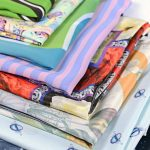 a selection of digitally bespoke printed scarves - close up in a range of colours and patterns