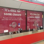 Virgin trains ticket counter blinds looking very effective when the counter is closed