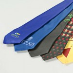 a selection of digitally printed ties close up in a range of colours